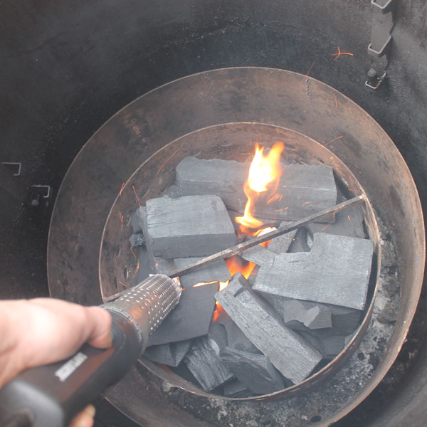 Using a heat gun to light the charcoal